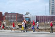 Cardinals fans pass by construction at the future site of Ballpark Village.