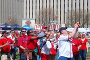 Cardinals fans catch prizes during the prep rally at Kiener Plaza.
