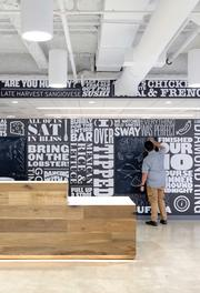 "The firm created a ""Table Story Wall"" in the reception area at Open Table that includes samples from stories and pull-quotes about dining experiences from employees."