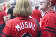 """Fans remember the late """"Stan the Man"""" Musial  by wearing his No. 6 jersey."""