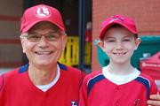 Frank Capelletti and his grandson Jack Tredway wait in line to enter Busch Stadium.