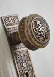 Detailed hardware on one of the doors in the circa-1887 mansion. The residence has nine bedrooms.