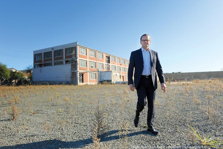 """""""There's a real opportunity to create a place as opposed to just building a one-off multifamily project,"""" says Joe Ernst of SRM Ernst of plans for a massive mixed-use project on the site of an old paint factory."""