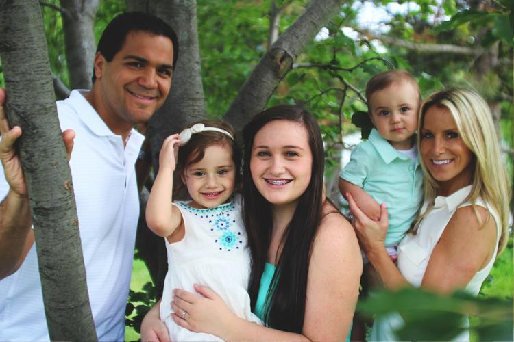"With his boxing career behind him, Joe Mesi is now focusing on his business ventures as well as his family which includes his wife Michelle and children, from left, Juliet, Hope and ""Baby Joe."""