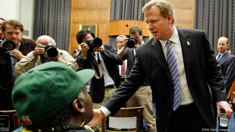"NFL Commissioner Roger Goodell greets Pro Football Hall of Fame player Willie Wood (green cap) before a hearing of the House Judiciary Committee about football brain injuries on Capitol Hill in Washington, D.C., in 2009. According to Wood's guardian, former NFL player Robert Schmidt, Wood is a ""living, breathing example of the issues of concussions and their correlation with dementia."""