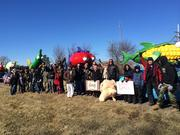 Protesters shout slogans outside Monsanto Co.'s headquarters in Creve Coeur on Tuesday, Jan. 28, 2014.