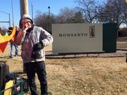 Adam Eidinger protests outside Monsanto Co.'s headquarters in Creve Coeur on Tuesday, Jan. 28, 2014.