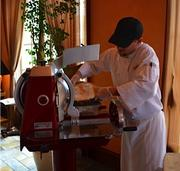 Local salumi is cut by this hand-cranked slicer