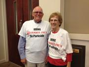 """Dr. Phillips residents Ken and Carolyn Robbins donned """"Bring Trader Joe's to Parkside"""" T-shirts for the Orange County Commission meeting on Jan. 28."""