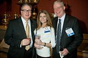 Dan Donahue of The Lenox Hotel with his wife Lauren of the Ocean Edge Resort and Jim Carmody of the Seaport Hotel & Seaport World Trade Center at the MFA's Koch Gallery during the Boston Business Journal's Book of Lists 2014 Gala.