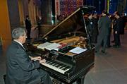 Mark Thirman of Vodafone was the pianist at the MFA during the Boston Business Journal's Book of Lists 2014 Gala.