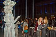 Blitz Media's Ellen Comley and Melissa Lea photograph one of the living statues during the Boston Business Journal's Book of Lists 2014 Gala.