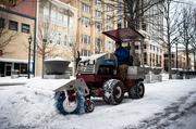 An employee of the public works department for the City of Raleigh clears the sidewalk along Fayetteville Street on Jan. 29.