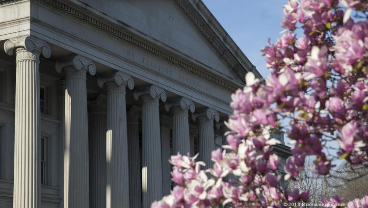 The U.S. Treasury stands behind a flowering magnolia tree in D.C. on April 8.
