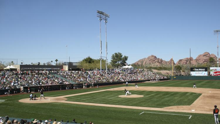 The last season for the Oakland A's at Phoenix Municipal Stadium was on where overall Cactus League attendance dropped.