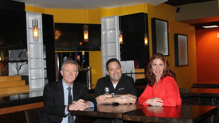 Chef Mike Isabella, center, with Ballston BID CEO Tina Leone and Simon Carney of Brookfield Properties. Isabella is partnering with the Ballston BID on a restaurant entrepreneurship challenge and will now open a second restaurant in the neighborhood.