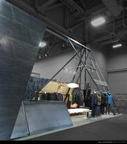 """Portland-based William Kaven Architecture designed a striking new A-framed shape """"booth"""" for Nau Inc.'s trade show appearances."""