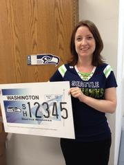 InvestED board president Lisa E. Schaures with Washington's new Seahawks-themed license plate.