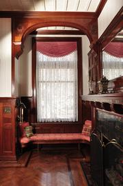 A cherry window seat in the front hallway.