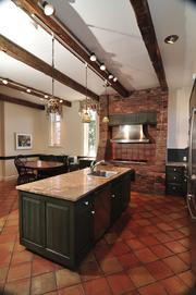 A large island and Viking stove are focal points in the kitchen.