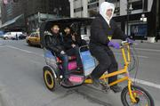 New Yorkers enjoy free beach-themed rickshaw rides courtesy of the Greater Fort Lauderdale Convention & Visitors Bureau outside Grand Central Terminal in New York.
