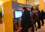 Commuters line up to win a free trip to Fort Lauderdale at the Hello Sunny beach promotion hosted by the Greater Fort Lauderdale Convention & Visitors Bureau at Grand Central Terminal in New York.
