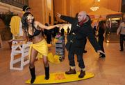 Sisco Muniz, of Brooklyn, surfs with a bikini clad model at the Hello Sunny beach promotion hosted by the Greater Fort Lauderdale Convention & Visitors Bureau at Grand Central Terminal in New York.