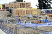 Work continues on The Park Moderns development in West Sacramento. About a third of its 32 single-family homes have already been sold, though it'll be months before the homes are ready.
