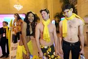 NBC TV personality Ben Aaron, right, joins bikini clad models at the Hello Sunny beach promotion hosted by the Greater Fort Lauderdale Convention & Visitors Bureau at Grand Central Terminal in New York.
