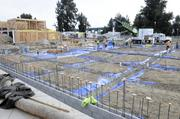 Work continues on The Park Moderns development in West Sacramento. About a third of its 32 single-family homes have already been sold, though it'll still be months before the homes are ready.