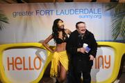 Richard Spain, of Ardsley, NY, poses with a bikini clad model at the Hello Sunny beach promotion hosted by the Greater Fort Lauderdale Convention & Visitors Bureau at Grand Central Terminal in New York.