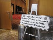 Regulators were wary of protesters disrupting hearings at the Pennsylvania Convention Center. To avoid the protests have have marked past hearings here, they had a greater police presence and posted this sign.