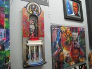 Three works that incorporate images of President Barack Obama.