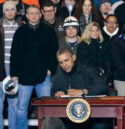 President Obama signs a memorandum for a retirement-savings account for Americans during a Wednesday afternoon visit to U.S. Steel Corp. in West Mifflin.