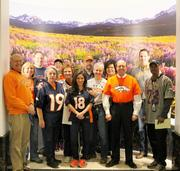 "Office of Attorney General John Suthers, Denver, www.coloradoattorneygeneral.gov -- ""Attached is a photo of Attorney General Suthers and some of our staff decked out for (our Jan. 17) United in Orange event. Each Friday throughout January, Department of Law employees dressed up showing their Broncos spirit. We captured that support in pictures (as we were able), and those who attended the various rallies shared some of those photos with us as well. We are documenting this excitement and support by posting the photos on our intranet. Also, the north side of the Judicial Center now boasts Broncos support, with each pillar covered in orange or blue. This photo was taken at the Ralph L. Carr Colorado Judicial Center.  Among the employees from the Attorney General's Office are: Back row 1st on left: Andrew McCallin, senior assistant attorney general for Consumer Protection. Andy will be sworn in as the newest Denver District Court Judge on Thursday. Front row 1st on left:  Bernie Buescher, Deputy Attorney General for State Services, formerly Secretary of State and former two-term member of Colorado House of Representatives. Front row 2nd from right:  Colorado's Attorney General John Suthers."" -- Carolyn Tyler, Communications Director & Public Information Officer; and Laura Morales, Communications & Marketing Specialist."