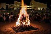 A large bonfire is part of the annual homecoming festivities at the Seven Hills School.