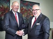 Scott Custer, left, and Joe Towell will lead the merged bank.