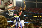 Louisville held on late Monday to secure an 82-76 victory over Michigan in the NCAA championship game at the Georgia Dome in Atlanta. U of L guard Russ Smith is shown above, cutting the net.