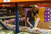 Sandra Martin, shipping assistant at Envision, labels items ready to be distributed. End products like these have Envision's manufacturing operation converting about 40 million pounds of material into goods every year.
