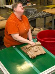 Wynona Salamon collects and sorts plastc bags on the production floor at Envision.