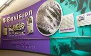 This large wall inside Envision's manufacturing facility displays the organization's history and mission.  The same information is written in braille along the backside of the adjoining handrail.