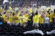 Michigan students celebrate a first half run by their team. There were no empty seats in this section when WSU students packed it for Saturday's game, though.
