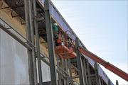 Crews are installing support beams for a new canopy system that will cover the roadway outside the terminal.
