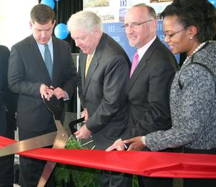 Mayor Walsh, John Drew, City Councilor Bill Linehan and Stat…Sen. Linda Dorcena Forry, cut the ribbon at Waterside Place.