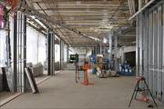 Framing for new walls and installation of utility conduit is underway on the concourse.