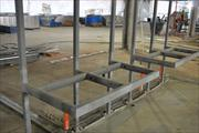 The terminal will have entirely new restrooms. Here, steel supports for sinks and counters are visible in a restroom near bag claim.