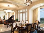 Rosen Shingle Creek Ibis suite: Features a baby grand piano in the center of the suite