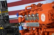 A bright orange engine sat near the stage during the president's appearance at GE's Waukesha gas engine plant.