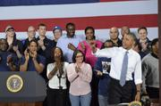 President Obama waves goodbye to the crowd at GE's Waukesha gas engine plant.