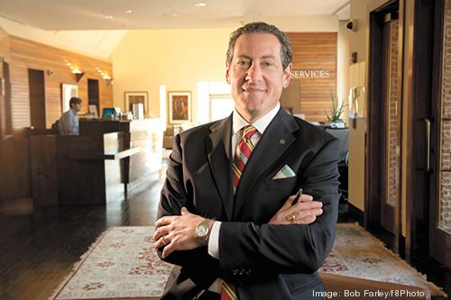 Robert Aland is a veteran banker, but he started out in the family clothing business.